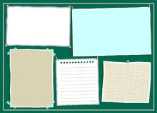 Colorful paper notes with pins and adhesive tape on green background. Stock Photography