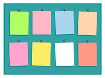 Colorful paper notes with pins on green background. Stock Photos