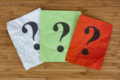 Colorful paper notes with question marks Stock Photo