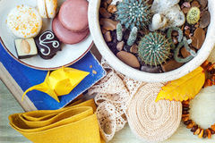 Free Colorful Paper Origami, Colored Macaroons, Vintage Lace Ribbon, Amber, Flower In A Pot, Book And Napkin On The Table. Still Life. Royalty Free Stock Image - 69229866