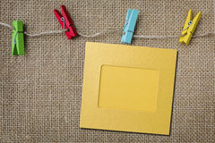 Colorful paper photo frame on sackcloth background Stock Images