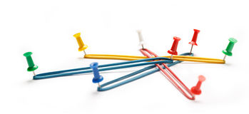 Colorful paper pins attached. To white paper Royalty Free Stock Photo