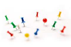 Colorful paper pins attached. To white paper Royalty Free Stock Image