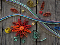 Colorful paper quilling. Paper quilling, colorful paper flowers on a wooden background royalty free stock images
