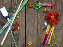Colorful paper quilling. Paper quilling, colorful paper flowers on a wooden background stock image