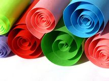 Colorful paper rolls. On white royalty free stock photo