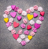 Colorful paper roses laid out in a heart shape on a granite background decorations for Valentine's Day top view close up Stock Images