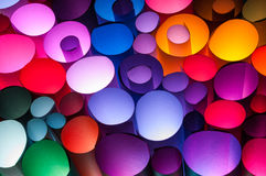 Colorful scrolls of paper. Abstraction created with colorful scrolls of paper lit from underneath Stock Image