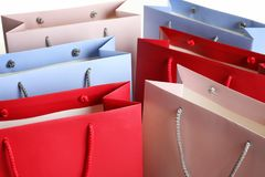 Colorful paper shopping bags as background. Closeup royalty free stock image