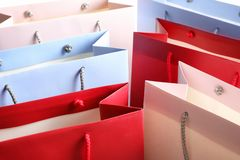 Colorful paper shopping bags as background. Closeup royalty free stock photography