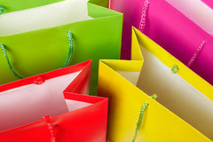 Colorful paper shopping bags background Stock Images