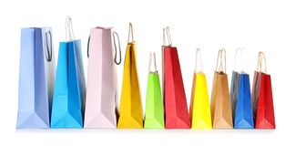Colorful paper shopping bags. On white background royalty free stock photo