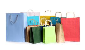 Colorful paper shopping bags. On white background stock images