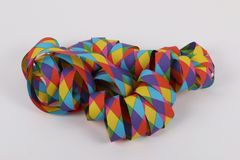 Colorful paper streamers in the studio. Colorful harlekin paper streamers lying in the studio stock image