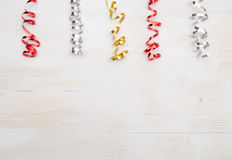 Colorful Paper Streamers on White Wooden Background. Royalty Free Stock Image