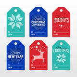 Colorful paper tags for presents with Happy Holidays, Merry Christmas and Happy New Year lettering. Vector banners. Xmas postcard. S. Knitted norwegian elements stock illustration