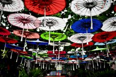 Colorful paper umbrella in the garden stock images