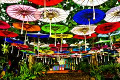 Colorful paper umbrella hanging in the sky stock photos