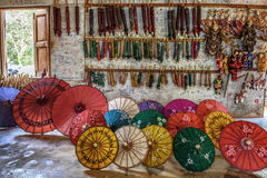 Colorful paper umbrellas arranged for sale Stock Photos