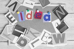 Colorful paper word IDEA on the cork board on table . Idea Concept. stock images