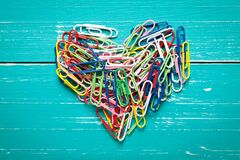 Free Colorful Paperclip Heart On Turquoise Table Royalty Free Stock Image - 201867616