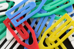 Colorful Paperclips. On black background Royalty Free Stock Photo