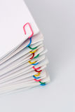 Colorful paperclips. And office paper Royalty Free Stock Photo