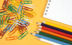 Colorful paperclips and crayons Stock Image