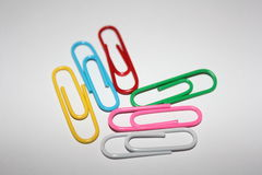 Colorful paperclips. Colorful metal paper clips on background Stock Photos