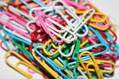 Colorful paperclips. Colorful metal paper clips on background Stock Photo
