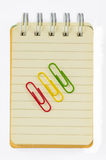 Colorful paperclips and note book on white background isolated Stock Photo
