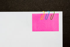 Colorful paperclips and post it on white background isolated Royalty Free Stock Photography