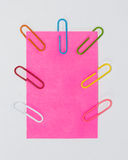 Colorful paperclips and post it on white background isolated Stock Image