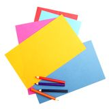 Colorful papers and crayons Stock Images