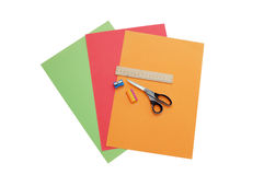 Colorful papers, scissors, pencil sharpener, ruler Royalty Free Stock Photography