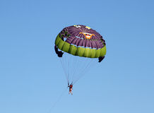 Colorful parachute. On a blue sky at the summertime Stock Photo