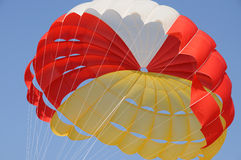 A colorful parachute. Under blue sky Royalty Free Stock Images