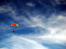 Colorful parachute against blue sky & white clouds Stock Photography
