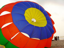 Colorful Parachute Background. A colorful background of a parachute in just landed on the ground Royalty Free Stock Images