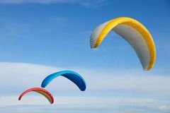 Colorful parachute flying Stock Image