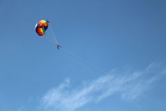 Colorful parachute. Flying in the blue sky Royalty Free Stock Images