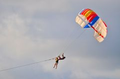 Colorful parachute. Playing with a colorful parachute on sky Stock Photo