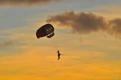 Colorful parachute. Playing with a colorful parachute on sky Stock Image