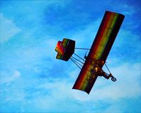 Colorful paraglider. Is flying in the bright blue sky Stock Photography