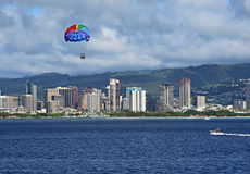 Colorful parasail over Honolulu Royalty Free Stock Photography