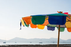 Colorful parasol on the beach Stock Photography