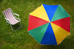 Colorful parasol and sunbed Stock Photo