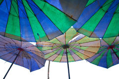 Colorful parasols on a a beach Royalty Free Stock Image
