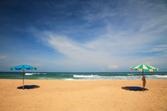 Colorful parasols with bed sheets for relax on beach Stock Photos
