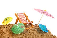 Colorful parasols and chair at the beach Stock Images